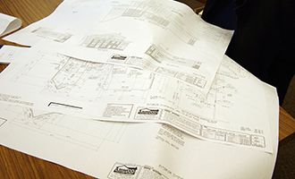 Building blueprints laid out on a table