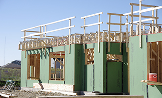 Building with exposed trusses and wall insulation