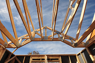 Skyward view of a roof truss and attached components